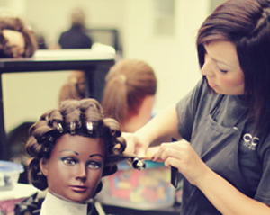photo of cosmetologist working on hair