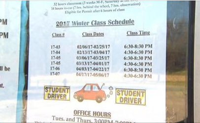 driver education class schedule sign in store window