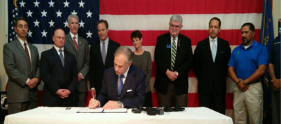 photo of Governor Abbott signing legislation
