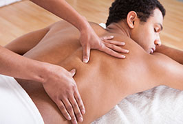 photo of man getting a back massage
